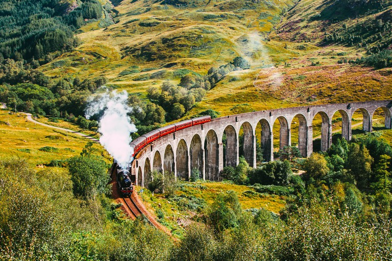 The Jacobite Steam Train, also known as the Hogwarts train as it was used in the Harry Potter movie franchise, traveling along the Glenfinnan Viaduct