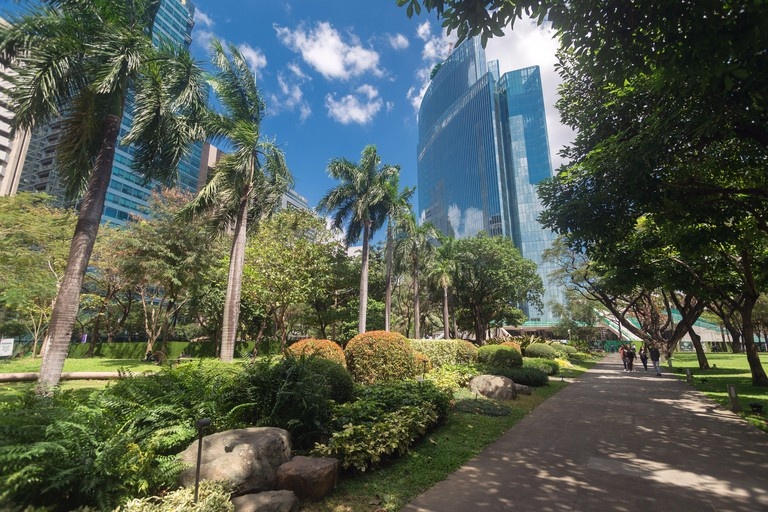 Metro Manila, Philippines - February, 12, 2020: Ayala Triangle gardens and park in Makati, on a sunny day