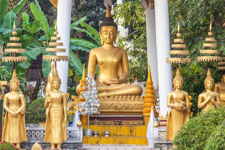 2B4ECG0 Laos, Vientiane, Wat Si Saket, Vientiane's oldest temple, exterior Buddha statues