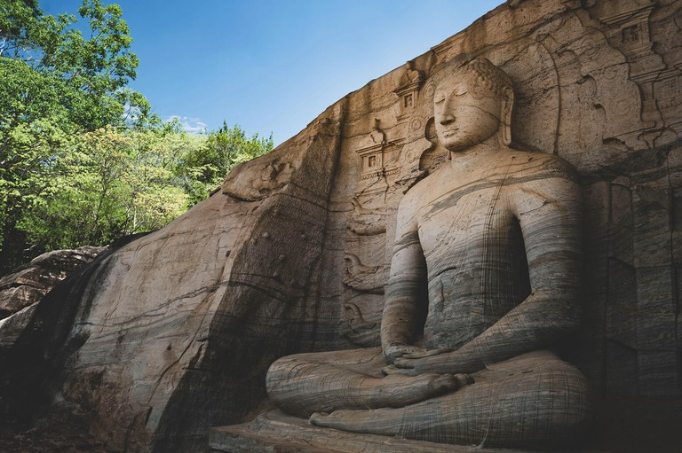Ruins of the Buddha statue in historical city of Polonnaruwa, Sri Lanka