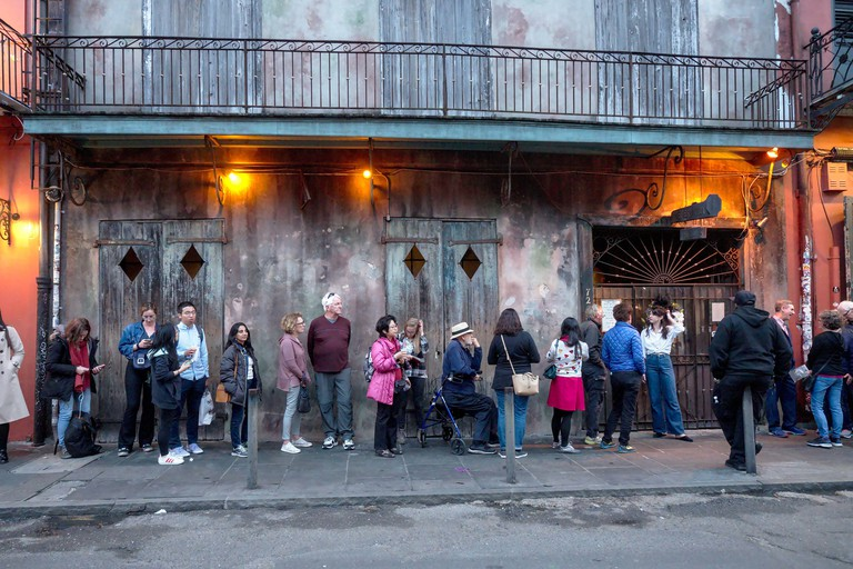 New Orleans, Louisiana, USA - 2020: People wait in line before a live performance by the Preservation Hall Jazz Band at the famous Preservation Hall.
