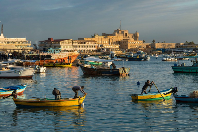 Egypt, Lower Egypt, the Mediterranean coast, Alexandria, the Corniche, fishing boats anchored in the bay, Qait Bay fortress at the back