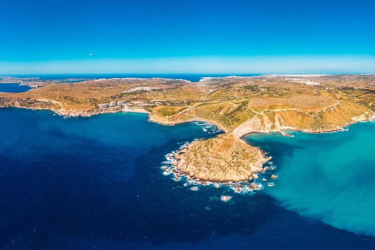 Golden Bay azure beach blue water sea, Malta. Concept travel. Aerial photo