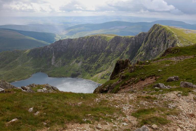 Summer view of Llyn Cau and the dramatic cliffs beneath the Minffordd Path ascending Cadair Idris