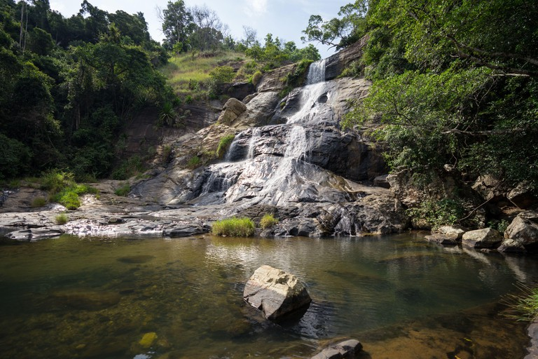 Powerful waterfall streaming from stony mountains