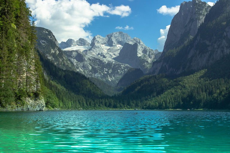 View of majestic mountains and lake.Nature getaway. Turquoise water of Gosau See,lake,Austria,Dachstein glacier in background.Vacation travel scene.