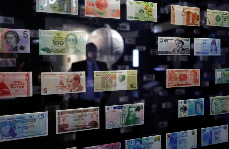 A visitor looks at international currencies on display at the money museum of Germany's federal reserve bank, Bundesbank in Frankfurt, Germany, April 1, 2019.  REUTERS/Kai Pfaffenbach
