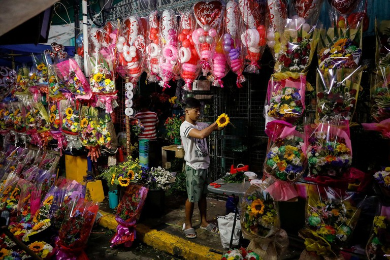 A vendor arranges a flower bouquet a day before Valentines Day in Dangwa Flower Market in Manila, Philippines, February 13, 2020. REUTERS/Eloisa Lopez
