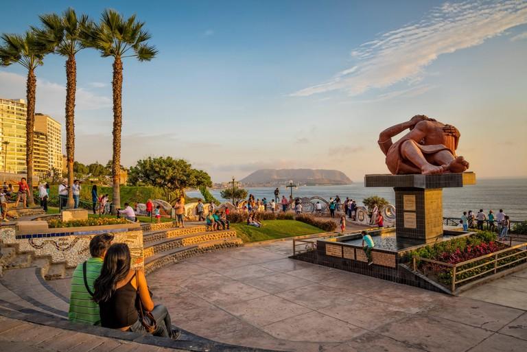 "Parque del Amor (Love Park) on El Malecon in the Miraflores district of Lima, Peru, with sculpture of embracing couple ""Barque del Amor"" by Victor Del"