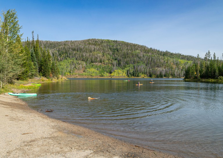 Clark, Colorado/USA - September 14, 2020:  Unidentified people enjoy kayaking and paddleboarding on Pearl Lake on a beautiful autumn day