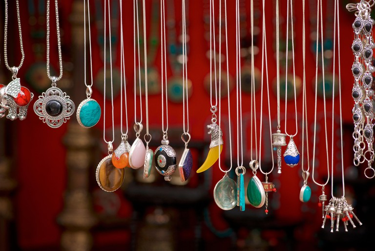 Indian jewellery with silver and stones hanging on a market stall. Leh, Ladakh, Jammu & Kashmir, India
