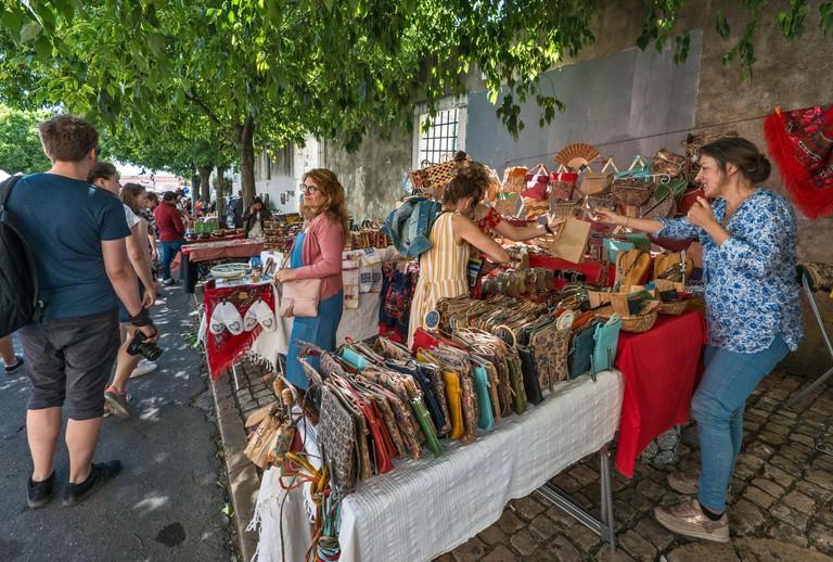 Flea market at Campo de Santa Clara square in Lisbon, Portugal