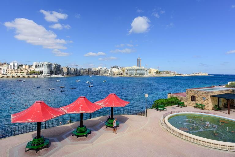 Popular holiday destination Sliema seafront looking across Exiles Bay towards St Julian's Bay & St Julians  Malta