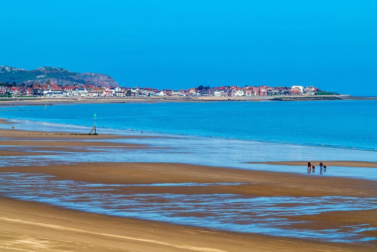 View across the sandy beach at low tide at Colwyn Bay a popular seaside resort in Conwy North Wales UK