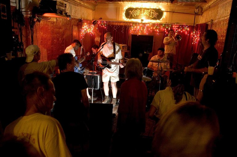 27 Sept 2005 - New Orleans, LA - Hurricane Katrina aftermath, New Orleans, Louisiana. Music returns to the city at the infamous Maple Leaf bar in Uptown New Orleans. Legendary local jazz man Walter 'The Wolfman' Washington (far left) and Tom McDonald (at