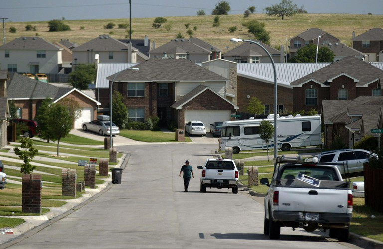Many of the homes in the Legacy Square addition of White Settlement were bought in 2003 in mass as unimproved lots by clan families of travellers according to an informant, as they sank roots in the metroplex rather than living on trailer parks. (Photo by