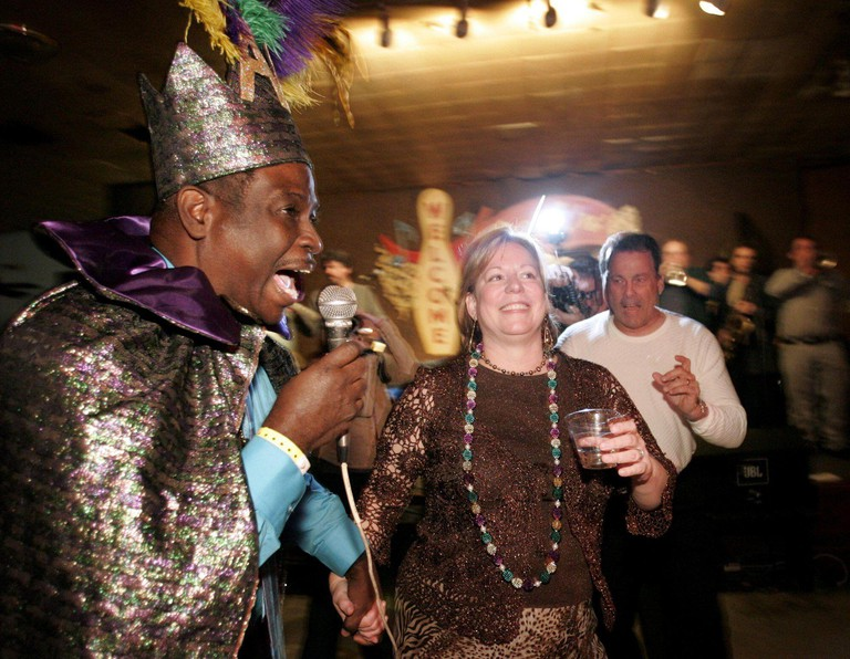"""AL """"Carnival Time"""" Johnson Sr. sings for the Krewe of Tucks Queen, Susan Clinton, at the Krewe of Tucks Queen's Party at Mid-City Lanes Rock 'N' Bowl in New Orleans, Louisiana, Sunday, January 15, 2006. (Photo by Vernon Bryant/Dallas Morning News/KRT)"""