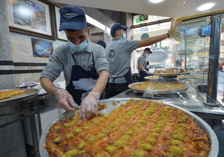 Employees prepare sweets at Habibah restaurant, amid the coronavirus disease (COVID-19) outbreak, in Amman, Jordan April 20, 2021. Picture taken April 20, 2021. REUTERS/Muath Freij