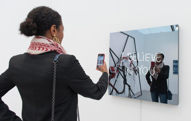 Regent?s Park, London, UK. 4 October, 2018. Frieze London features more than 160 of the world?s leading galleries with the opportunity to view and buy art from over 1,000 of today?s leading artists. Image: Jeppe Hein. I Believe In You (handwritten), 2018.