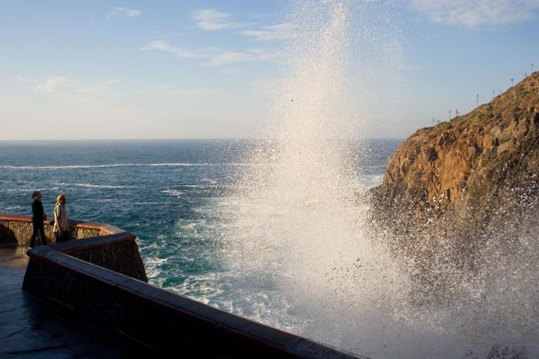 tourists stand next to the blow hole at La Bufadora Baja California Peninsula Mexico