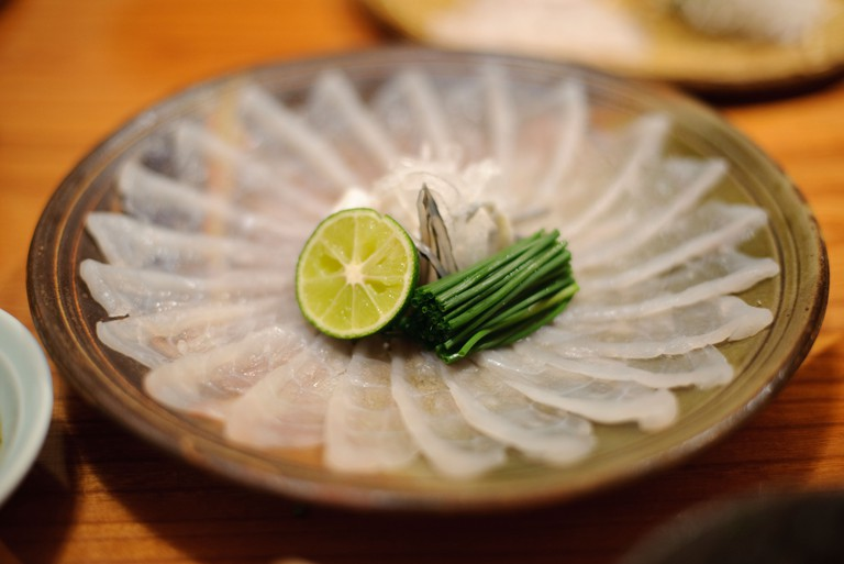 Fugu sashimi served with chives, fugu skin and yuzu sudachi citrus, Otsubo fugu restaurant, Tokyo, Japan, October 24 2009.