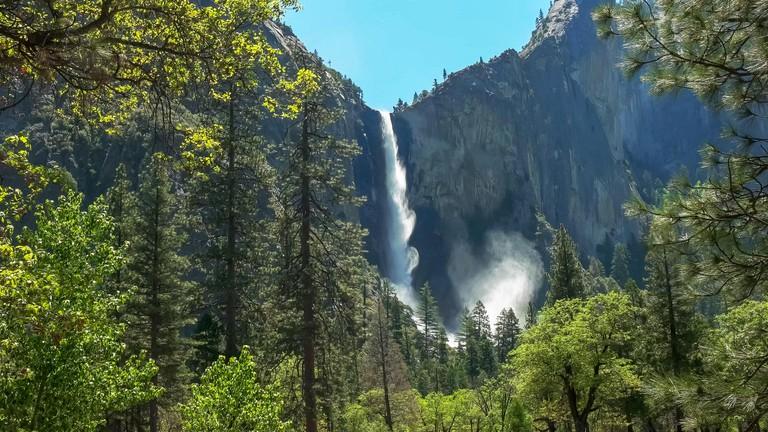 a sunlit bridalveil falls in yosemite national park