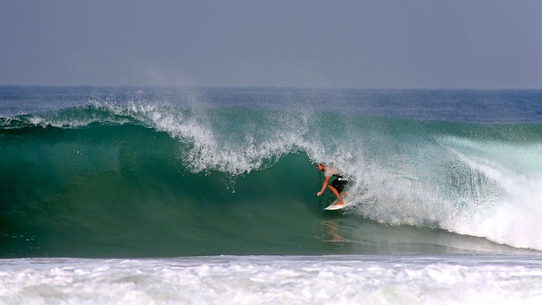 Surfing deep in the tube of a powerful wave. Puerto Escondido, Oaxaca, Mexico, North America