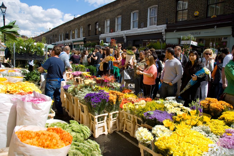 Columbia Road packed with people at the Columbia Road flower market held every Sunday.