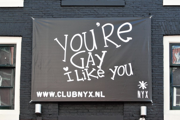 Black advertisement banner of dance and nightclub called Club NYX