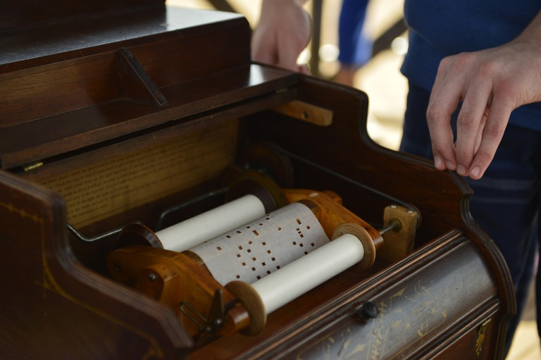Brooklyn, New York, USA. 9th Aug, 2014. Organ grinder Ian Fraser, 13, of Staten Island, plays a 1881 Celestina Organette, made by the Mechanical Orguinette Company of New York, at the Fourth Annual History Day at Deno's Wonder Wheel Amusement Park and The