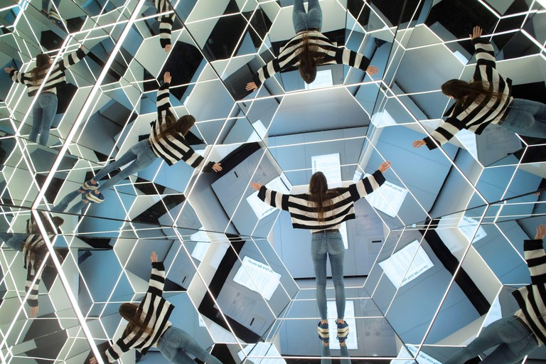 A woman visits the exhibition 'Mirrors: In and Out of Reality' in Barcelona, Spain, 12 April 2019. Maths, physics and photonics melt in this exhibition presented by Cosmocaixa in which visitors can enter a big kaleidoscope to walk through and experience w