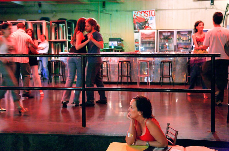 Young couples and crowd dancing Tango, at ?La Viruta? Milonga. Palermo neighborhood, Buenos Aires, Argentina
