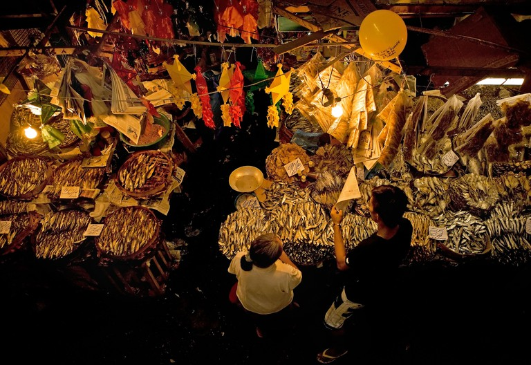 Fish stall at a night market in the Philippines.