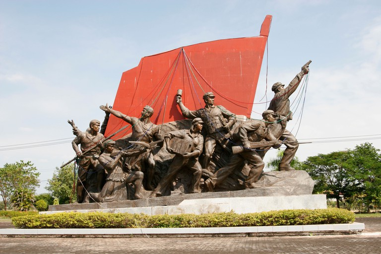 DCDTCF Communist memorial, laotians fighting for freedom in front of a red flag, Kaysone Phomvihane Memorial Museum, Vientiane, Laos