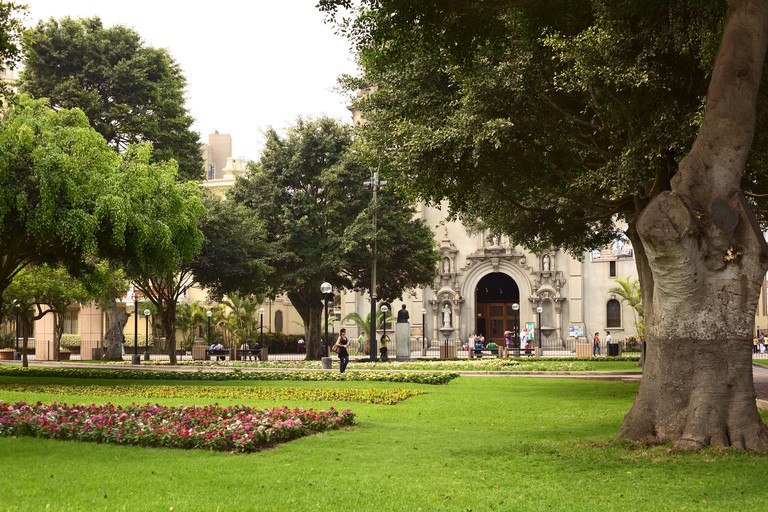 Kennedy Park with the entrance to the church of La Virgen Milagrosa in Miraflores, Lima, Peru