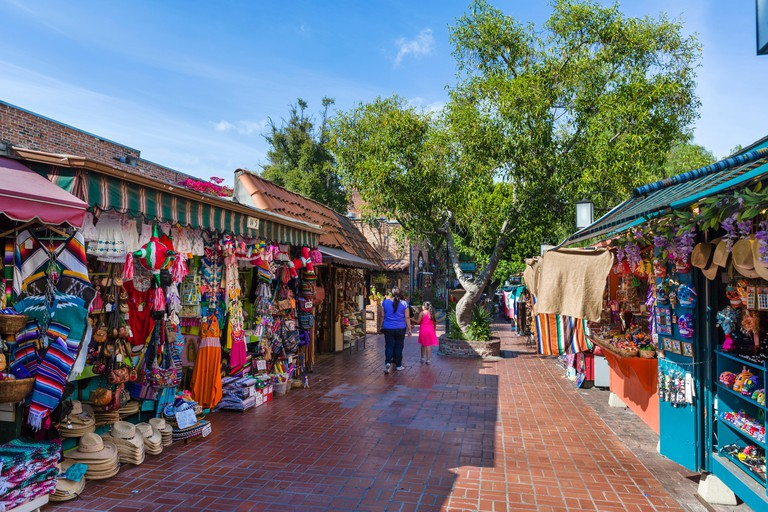 Shops and market booths on Olvera Street in Los Angeles Plaza Historic District, Los Angeles, California, USA
