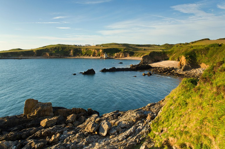 Porth Padrig part of the wider Cemaes Bay with a distant view of St Patricks church at Llanbadrig on the northern coast. Image shot 2014. Exact date unknown.