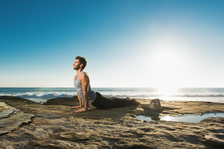 Upward dog yoga pose, Windansea beach, La Jolla, California