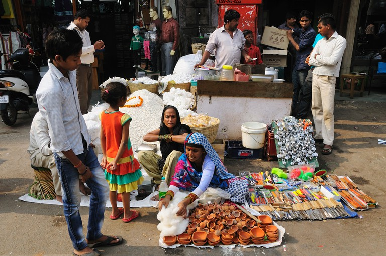Woman selling cray oil lamp for Diwali festival