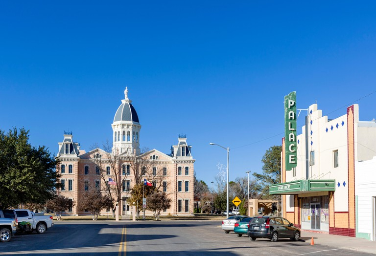 Main Street in downtown Marfa with the Presidio County Courthouse at the far end, Texas, USA