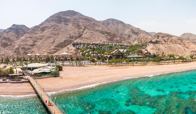 Eilat, Israel: Panorama from the Tower of Underwater Observatory Marine Park in Eilat. Desert mountains with hotels areas. Eilat is ble