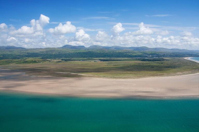 Aerial view of Glaslyn estuary, Morfa Harlech sands and Rhinog mountain range Snowdonia National Park Gwynedd North Wal