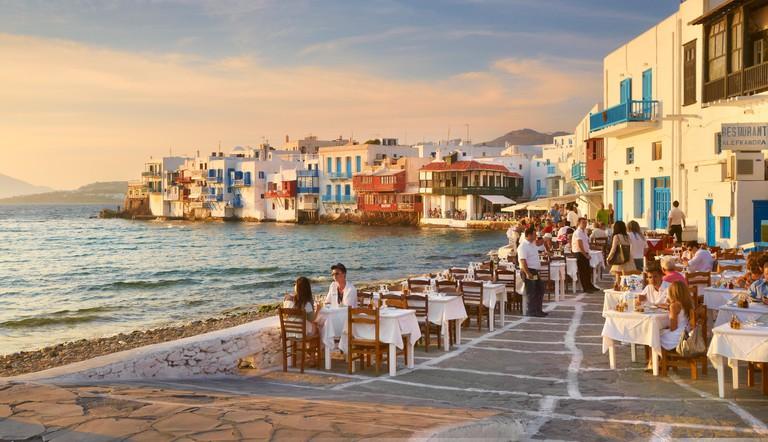 Outdoor restaurant, Mykonos Island Old Town, Little Venice in the background, Greece