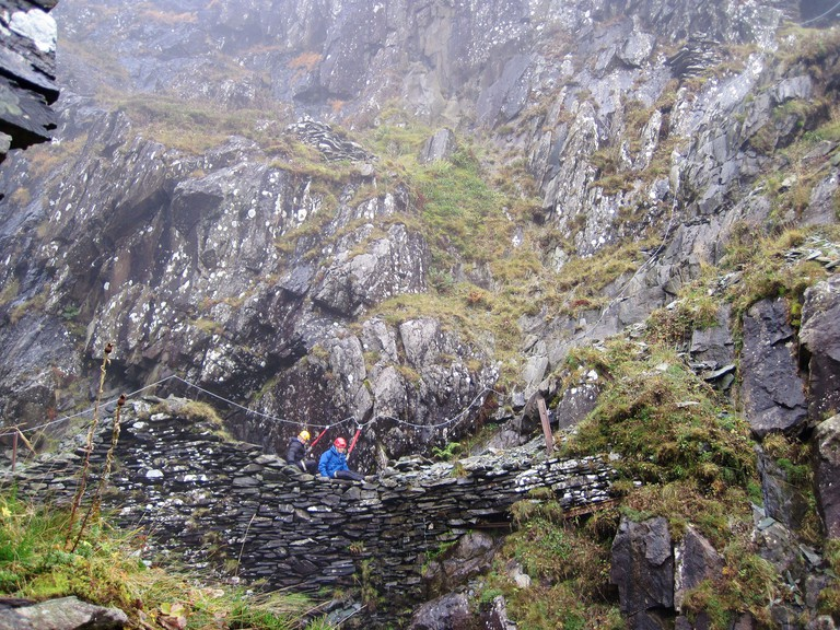 Tourists follow a Via Ferrata route at Honister Slate Mine in the Lake District.