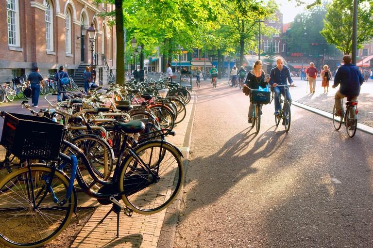 Couple on bikes in Spui square, Amsterdam