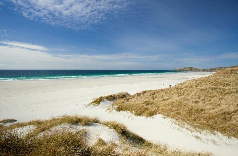 The pristine white sands of Traigh Eais beach on the Isle of Barra, Outer Hebrides, Scotland.