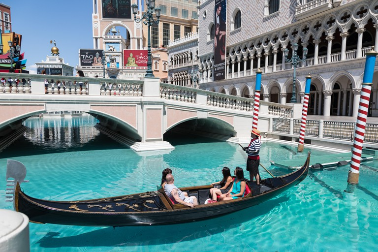 Las Vegas, Nevada, USA - September 1, 2017: Tourists enjoying ride in gondola at Grand Canal at The Venetian Resort Hotel and Casino.  This luxury hot