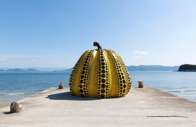 NAOSHIMA, JAPAN. JUNE 6: Yayoi Kusama's giant pumpkin sculpture in Naoshima. June 6, 2016 on Naoshima Art island, Japan.