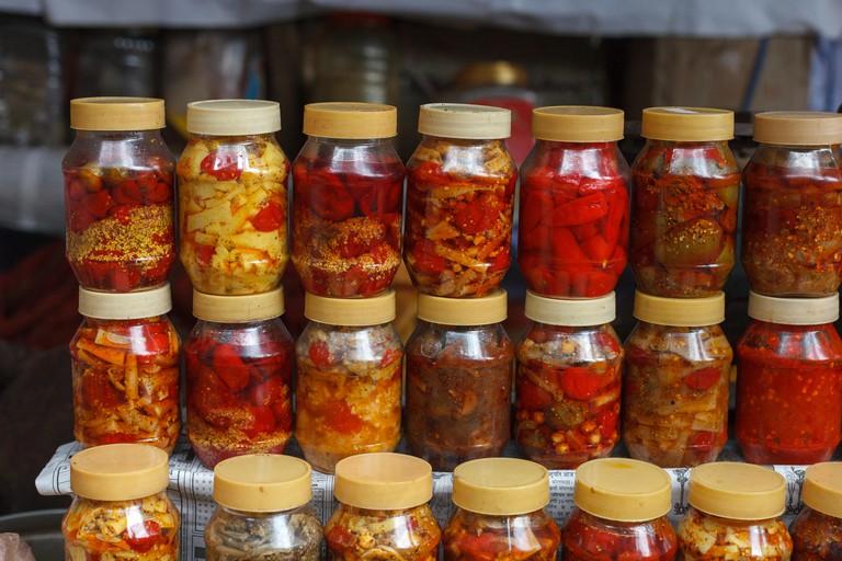 Jars of Indian pickled vegetables for sale on the market