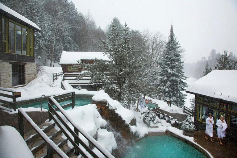 Canada, Quebec province, Laurentians region, Mont Tremblant, baths of the scandinave Spa of Mont Tremblant under the snow